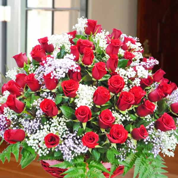 99 Red Roses in Basket All Round Arrangement