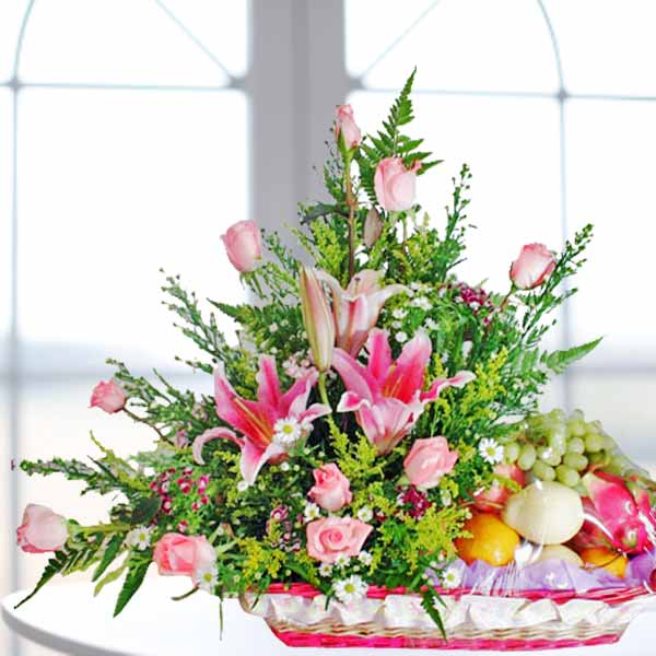 Pink Lily and Roses Fruits Basket Arrangement
