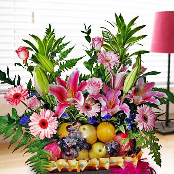 Pink Lily, Gerbera & Roses Fruits Basket Arrangement