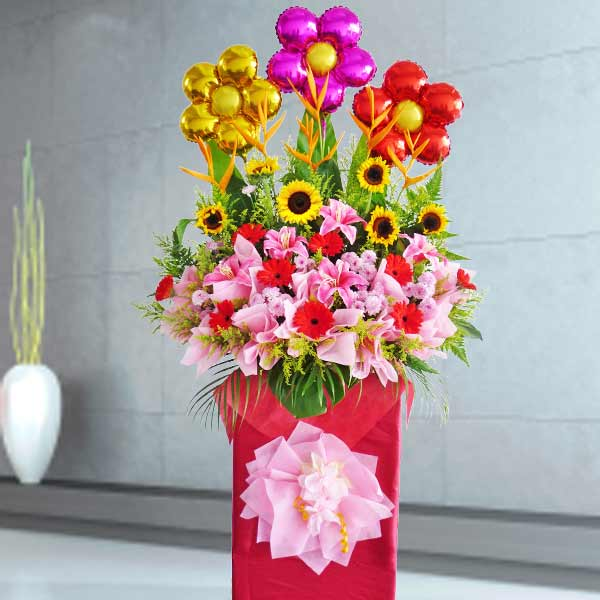 SunFlower, Gerbera & Artificial Lily Arrangement in Box Stand