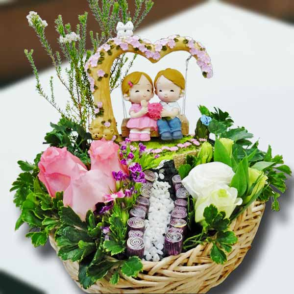 Couple On A Tree Swing Resin Figurine & 3 Peach Roses in Basket.