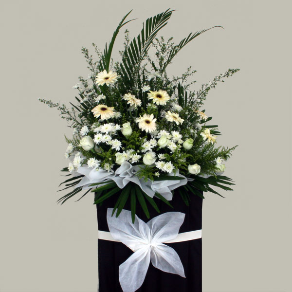 Yellow Gerbera and white Roses On box stand