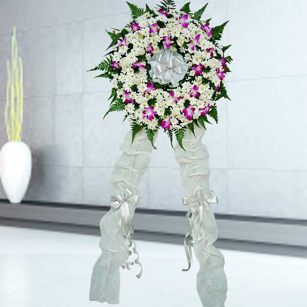 "Orchids & White PomPom Wreath 22"" With Metal Stand"