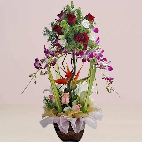Purple orchids topiary flowers arrangement