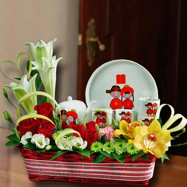 Happiness Tea Set with Lilies, Roses & Cymbidium Orchids in Basket