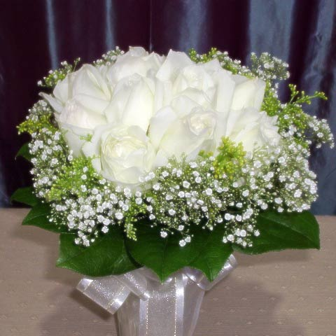 12 White Roses with Babybreath and Sala-Tip Foliage Handbouquet
