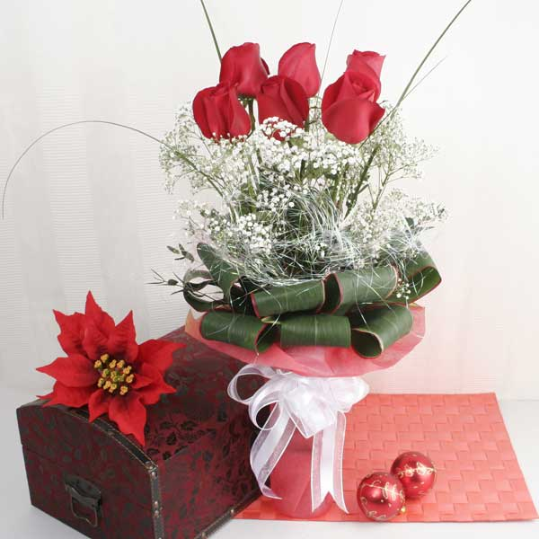 6 Red Roses with babybreath and cordyline foliage in Glass Vase
